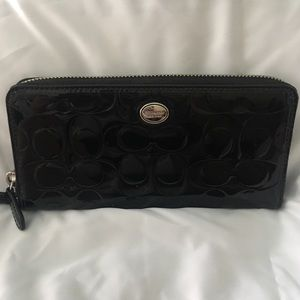 Like new Black patent leather Coach zip wallet